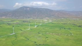 Wind energy station aerial view. Windmill turbines on green field and mountain landscape. Alternative natural source and. Ecology conservation. Wind generation stock video footage