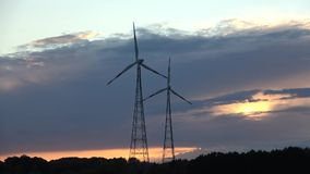 Wind energy technology - turbine, chicken pox, energy production - green technology. The solution of clean and renewable energy, the time interval at sunset stock footage