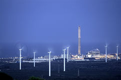 Wind and Energy. Wind turbine with power plant and industries. Night photography with long exposure Stock Image