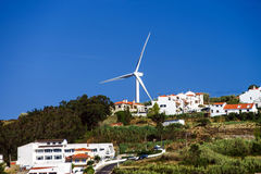 Wind energy turbine power station over the village Royalty Free Stock Images