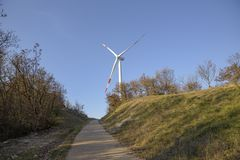 Wind energy. Wind turbine for the production of clean energy and conservation of the environment. Trentino, Italy.  royalty free stock photos