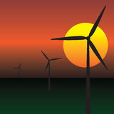 Wind energy turbines. Over sunrise sky Stock Photography