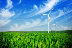 Wind energy turbines on the field Royalty Free Stock Image