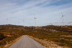 Wind energy turbines. In a landscpae over a beautiful blue sky stock photography