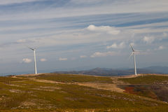 Wind energy turbines. In a landscpae over a beautiful blue sky stock image