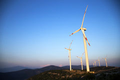 Wind energy turbines are on the mountain and produce cleanest electric energy Stock Images