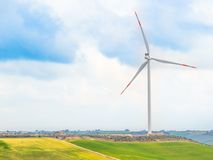 Wind energy turbines are one of the cleanest, renewable electric energy source, under blue sky with white clouds Stock Images