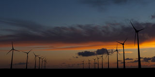 Wind energy turbines at sunset Stock Photography