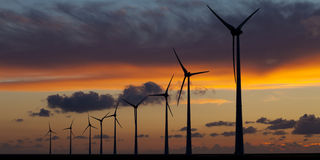 Wind energy turbines at sunset royalty free stock image