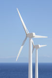 Wind energy. Two wind turbines  shore energy Royalty Free Stock Photography