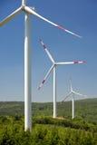 Wind energy,white turbine Stock Images