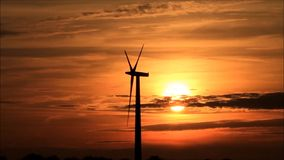Wind energy, wind turbine at sunset stock video footage