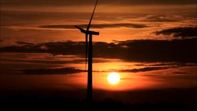 Wind energy - wind turbine at sunset stock footage