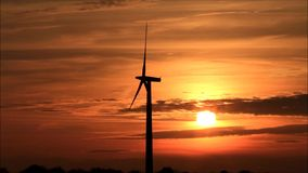 Wind energy - wind turbine at sunset stock video