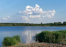 Wind energy - wind turbines in front of a cloud formation stock photography