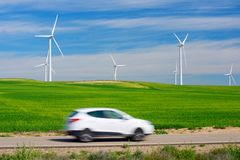 Wind energy. Windmills for electric power production and car, Zaragoza province, Aragon, Spain Royalty Free Stock Photography