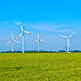 Wind energy wowers standing in the field Stock Photo