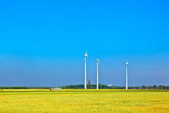 Wind energy wowers standing Royalty Free Stock Photos