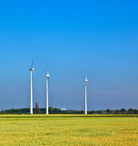 Wind energy wowers standing in the field Stock Photography