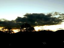 wind för abstraktionstormsolnedgång arkivfoto