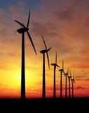 Wind farm. Wind turbines farm at sunset Stock Images
