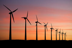 Wind farm. Wind turbines farm at sunset royalty free stock photography