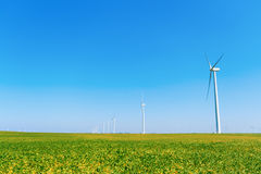 Wind Farm. Wind turbines on a farm in blue skies Royalty Free Stock Image
