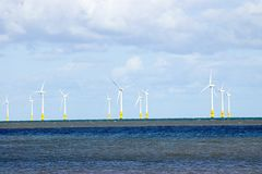 Wind farm. Mast and sails of wind farm in the north sea stock photos