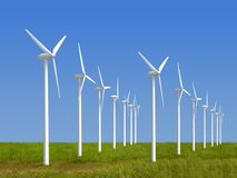 Wind Farm. In grass over blue sky Royalty Free Stock Images
