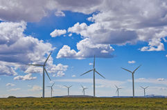 Wind Farm. On the plains of Wyoming, with some billowy clouds royalty free stock image