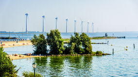 Wind Farm along the shore of the inland sea named IJselmeer. Seen from the historic fishing village of Urk in the Netherlands Royalty Free Stock Photos