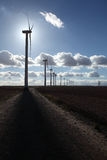 Wind farm in backligth. Large wind farm in the countryside Stock Images