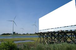 Wind  farm with billboard Stock Photo