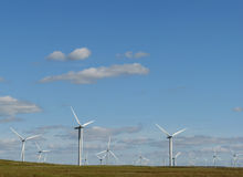 Wind farm and blue sky. Line of wind turbines on a Scottish wind farm in Europe Stock Images