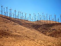 Wind farm on desert hill Royalty Free Stock Images