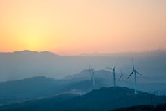 Wind farm with distant mountains Royalty Free Stock Image