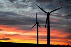 Wind farm at dusk. Two wind turbines at dusk stock photo