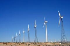 Wind farm energy. Wind farm turbines collecting energy Royalty Free Stock Photo
