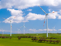 Wind farm in a field Royalty Free Stock Image