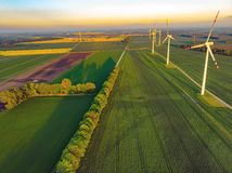Wind farm and green fields. Wind farm green fields windfarm alternativeenergy eco ecology power electrical greenpower technology turbine country agriculture royalty free stock photos