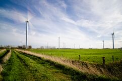 Wind Farm on Green Grass Pastures Royalty Free Stock Photo