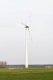 Wind farm. High windmills field Stock Photos