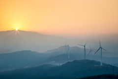 Wind Farm In Sunset Royalty Free Stock Photos