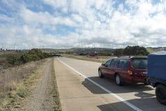 Wind farm horizon cars stock photos