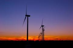 Wind Farm night sky. Wind Turbines against night sky Stock Photo