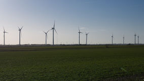 Wind Farm. A wind farm outside Bradwell, Essex, England, UK stretches away into the distance Royalty Free Stock Photos