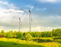 Wind farm with rainbow Stock Photo