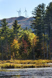 Wind farm on ridge with fall foliage in Plymouth, New Hampshire. Windmill farm on colorful ridge, with fall foliage of Quincy Bog below in Plymouth, New Stock Images