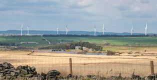 Wind farm and Scargill Reservoir on the North Yorkshire Dales royalty free stock image