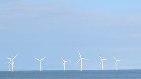 Wind farm at sea. Royalty Free Stock Images